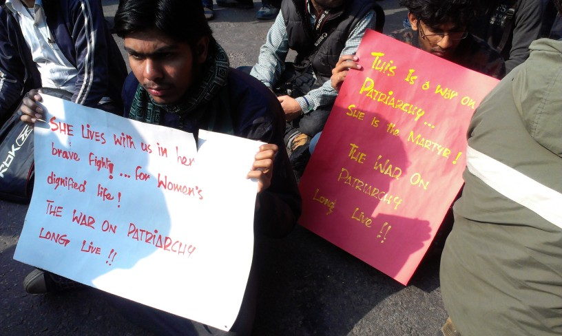 At the condolence meeting, December 29, half the gathering shouted slogans: Hang The Rapists! We Want Justice!  This is the other half, silent, holding up posters that do all the talking.