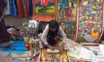 """My name is Joya Chitrakar, fourth-generation chitrakar."" From a family of painters in Mednipur."