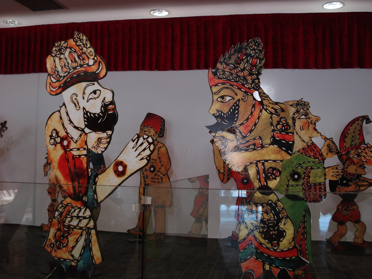 (Shadow puppets: Karagoz and Hacivat, with their heads. From Wikipedia.)
