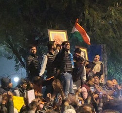 At police headquarters, Gandhiji, Dr Ambedkar, the flag and students